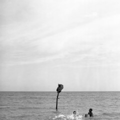 The Call of March Girls (dave.carswell) Tags: ocean blackandwhite bw 120 6x6 film beach swim children play pacific kodak squareformat png splash papuanewguinea kodaktmax400 pentaconsix marchgirls centralprovence
