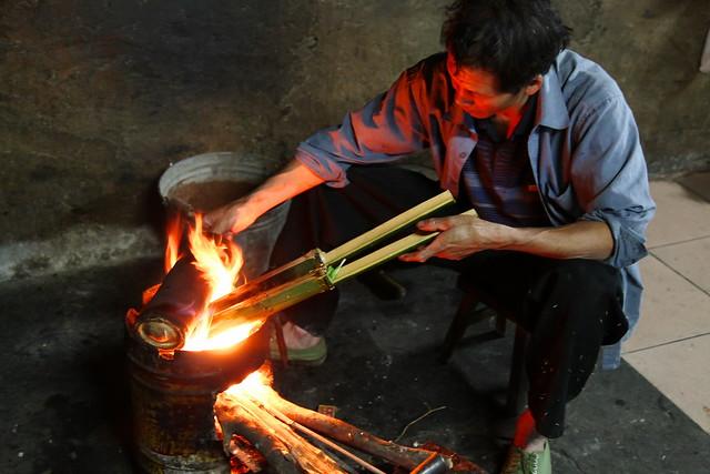 A man cooking Longsheng's traditional food, Guangxi, China