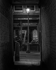 Night in Goodwin's Court (Mike Hewson) Tags: photo24 london street streetsoflondon night longexposure bw blackandwhite blackwhite monochrome blancoynegro noiretblanc coventgarden lamp streetlight gaslamp panasonic lumix gh5 micro43 microfourthirds mirrorless noflash