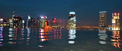 Swimming on top of the world (gerard eder) Tags: world travel reise viajes asia southeastasia singapore marinasandsbay marinabaysands hotel pool skyline paisajes outdoor city ciudades städte cityscape cityview stadtlandschaft panorama night nikon nightviews nacht noche reflections spiegelung wasser water