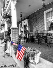 """American flags on the front porch"" Georgetown, DE (delmarvausa) Tags: thebrickhotel georgetownde sussexcountydelaware sussexde delmarva thecircle georgetown delaware delmarvapeninsula hotel historic delmarvahistory historichotel georgetowndelaware sussexcounty southerndelawaware sussexcountyde"