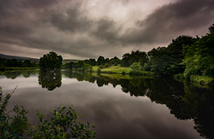 dark reflections (Phil-Gregory) Tags: nikon d5200 tokina 11mm 1120mmproatx 1120mm 1120 1116mmf8 1120mmf28 116proatx wideangle ultrawide wide water lake clouds dark relections mood peakdistrict naturalphotography national naturalworld nature natural nationalpark naturephotography light lightroom scenicsnotjustlandscapes waterscape landscape trees peace perspective uk derbyshire field fly colour green