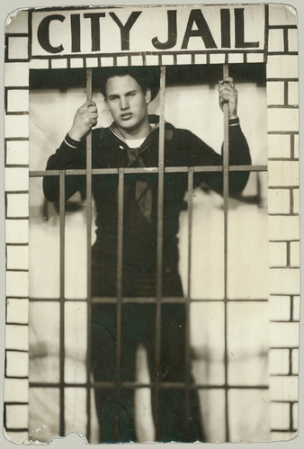 Sailor behind bars arcade photo