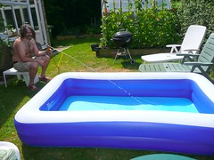 fillling the paddling pool (CANDYTANGERINE) Tags: blue water pool garden fun paddle
