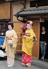 Geiko and Maiko, Fumikazu and Momokazu, at Gion in Kyoto, Japan;  (Nullumayulife) Tags: pink blue red orange woman white black flower cute green art colors girl beautiful beauty yellow japan female silver asian real japanese gold kyoto noir purple femme traditional young violet exotic maiko geiko geisha kawaii  belle   nippon kimono gion  blanc  japon giappone nihon 2010   japao japons       japanisch  kanzashi  japonaise       japanishe fumikazu   momokazu