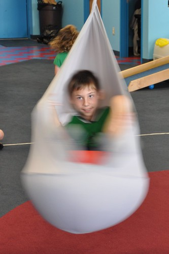 Benton in the spinning swing
