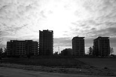(...uno che passava... (senza ombrello)) Tags: bw clouds bn palazzo piazzaaffari bncitt zingonia verdellino