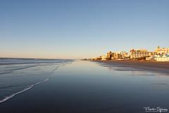 Linea de Agua (FlavioSpezia) Tags: ocean sea sky costa sun reflection sol beach skyline clouds sunrise coast mar town nikon pueblo playa amanecer cielo nubes reflejo horizonte oceano golondrinas orilla sanbernardo terns costaatlantica d40