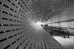 Endless (Brian Utesch (shutterBRI)) Tags: travel light people blackandwhite bw usa museum architecture america canon lights washingtondc us vanishingpoint dc districtofcolumbia unitedstates modernart capital perspective july tunnel walkway artmuseum nationalgalleryofart 2010 shutterbri challengeyou challengeyouwinner cywinner superaplus aplusphoto brianutesch