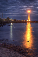 Beacon of light (J-C-M) Tags: lighthouse reflection beach water photoshop boats bay nikon australia melbourne victoria d200 hdr stkilda topaz portphillip beaconoflight photomatix