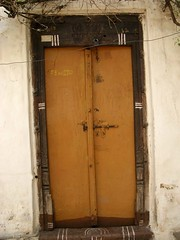 Secure and Yellow... (Hema Narayanan) Tags: windows doors doorway northkarnataka jharokas doorsoftheworld villagedoors oldendoors