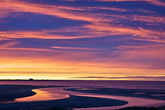 Outstanding Natural Beauty. (Ian McWilliams.) Tags: sunset red sea sky orange castle yellow clouds river coast purple northumberland northumbria northeast bamburgh holyisland lindisfarne rta lindisfarnecastle budlebay areaofoutstandingnaturalbeauty outstandingnaturalbeauty georgethebotter
