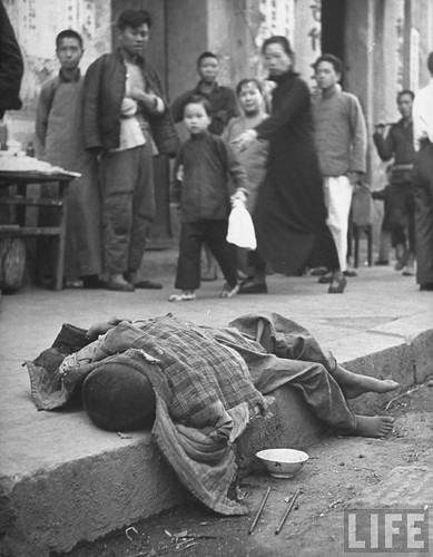 Famished Chinese child dying in a gutter, by George Silk 1946