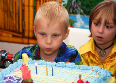 Vaughn Blows Out the Candles (Harpo42) Tags: birthday party summer cake kids candles cousins july luau vaughn annelise 2010