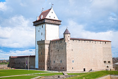 narva castle (Konstantin Yolshin) Tags: old travel blue summer sky white building green tower castle history beautiful grass stone wall architecture clouds ancient war europe estonia european view fort citadel background landmark baltic medieval historic knight historical bastion stronghold fortress hdr narva