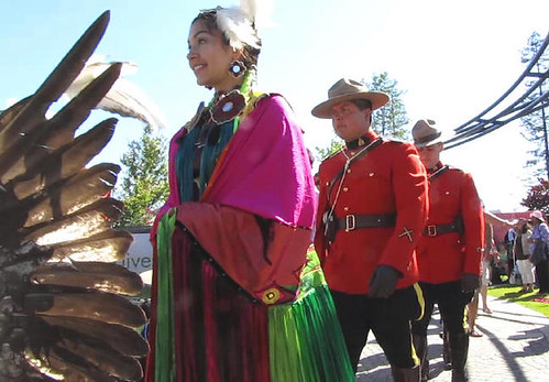 RCMP Mounites Follow the First Nations at the Parade of Flags Opening Ceremony, Surrey Fusion Festival 2010 Multicultural and Diversity Celebration in Greater Vancouver