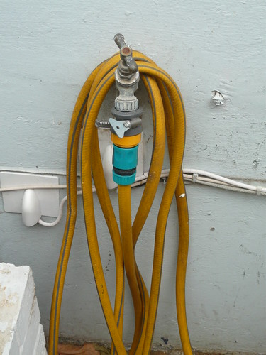 Water hose fixing