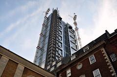 Overshadowed (HaHa UK) Tags: new old blue sky building london tower monument delete10 architecture clouds skyscraper delete9 delete5 aquarium delete2 crane delete6 delete7 delete8 delete3 delete delete4 save broadgate scaffold gherkin lloyds tower42 bishopsgate cladding cityoflondon herontower deletedbydeletemeuncensored