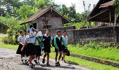 Bali School Kids Going Home (cwgoodroe) Tags: new old school summer bali sun stone kids children indonesia rice statues agriculture mountians patties riceterraces ubud seminyak batubulan