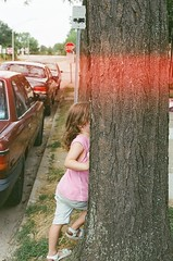 light....leak.... (A. Manzoni) Tags: street girls ohio red baby tree film car sign 35mm matt table minolta chairs little cincinnati plastic stop laundry blonde pepsi hispanic fairmount dowtown dryer