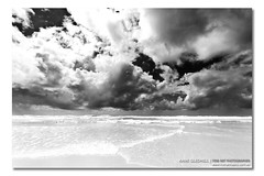 The Ocean vs The Water Vapor ([ Kane ]) Tags: ocean sea sky blackandwhite white storm black beach water weather clouds contrast canon dark photography sand salt sigma wave australia nsw kane 1020mm 2009 vapour timeless anseladams gledhill sigma1020 brunswickheads 400d kanegledhill wwwhumanhabitscomau kanegledhillphotography canon400dsigma1020