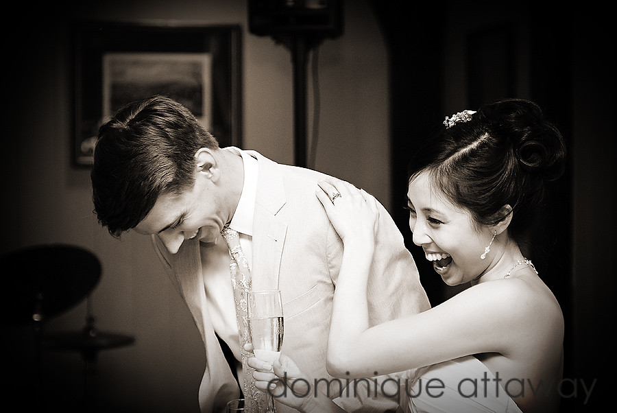 newlywed couple laughing