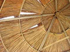 Hiding from the Sun (FlipMode79) Tags: beach greece mykonos elia beachumbrella eliasbeach