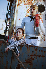 French Navy III (Alexander Kuzmin) Tags: sea portrait fashion scarf french boat marine couple ship outdoor availablelight ambientlight stripes navy tie naturallight overlay rope ring story sling round anchor sail series vest sailor shadowplay lifebuoy choker necktie  openair mariner rainman doubleportrait alexanderkuzmin kuzmin difital canon5dmarkii rainbook