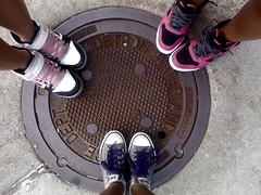 211.365 warped tour (Kali Koldwater) Tags: pink summer orange concert shoes purple michigan warpedtour gray detroit july sidewalk hightops manhole sewer 2010 nikes jordans convers