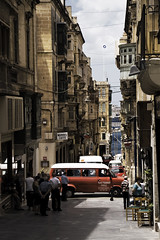 Valletta Street_Tint_MG_2163_By Phil Ovens (Pitcher_Phil) Tags: street people signs cars buses stone architecture buildings harbour malta vehicles balconies valletta