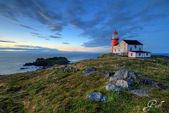 Painted Lighthouse (gwhiteway) Tags: ocean travel light lighthouse seascape canada tourism sunrise newfoundland landscape rocks atlantic phare pictureperfect aton ferryland navigationalaid navaid aidtonavigation signalisationmaritime