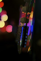 'Scuse me while I kiss the sky (Jazzyblue TR) Tags: pink blue red reflection green yellow canon golden purple bokeh guitar fenderstratocaster electricguitar sigma50mmf14 bokehhearts rebelt1i