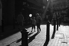 London summer [21] (Che-burashka) Tags: street light summer people urban blackandwhite bw sun london childhood square gallery shadows child candid leicester joy balloon mother highcontrast happiness places bn safety backlit tgif beams londonist mywebsite ef28mm londonsummer canonef28mmf18usm flaire contredejure londonlightcolour