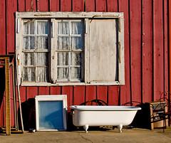 Bathtub (photographyguy) Tags: bathtub jefferson jeffersontx redwhite antiques easttexas windows redandwhite clawfoot spaceheater clawfoottub texas red