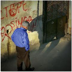 Thinking about life (pixel_unikat) Tags: door shadow man wall turkey person walk nine cap lane graffito textured izmir muralpainting 500x500 thankstoskeletalmessfortexture