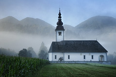 Slovenia - Bohinjska Bistrica - Church at dawn (Darrell Godliman) Tags: travel copyright mist travelling tourism church misty fog sunrise landscape dawn nikon europe foggy scenic eu explore slovenia valley slovenija europeanunion atmospheric bohinj allrightsreserved travelphotography julianalps cerkev europeseunie slovenien unineuropea instantfave 5photosaday unioneuropenne radovljica republikaslovenija omot travelphotographer bohinjskabistrica flickrelite dgphotos darrellgodliman wwwdgphotoscouk dawnraid d300s dgodliman bitnje nikond300s seriesx3 sloveniabohinjskabistricachurchatdawndsc2602