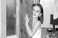 A smile hard to refuse (flaccphotography) Tags: door portrait girl smile pose sister daughter romania frame hold bistrita smilehardtorefuse