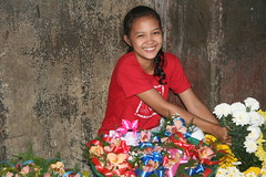 Asia - Philippines / Leyte - girl selling flowers in Tacloban City (RURO photography) Tags: voyage travel tourism church fun religious photography asia catholic asahi photos religion reis tourist christian believe asie lonelyplanet