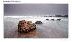 Sea Rocks, Northumberland - Explored (awhyu) Tags: pictures uk sea seascape english nature water rain rock landscape grey coast town bed rocks long exposure colours natural northumberland bamburgh berwick upon tweed