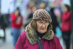 Lady with beret (Frank Fullard) Tags: frankfullard fullard candid street portrait galway red irish ireland stripes collar fur beret