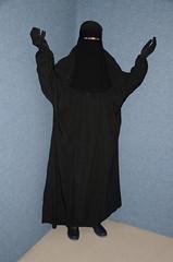 Black rainwear under the Jilbab (Warm Clothes Fetish) Tags: slave girl warm hot sweat torture winter niqab burka chador hijab rainwear fleece fur boots hat maid