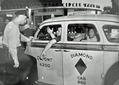 Police officer speaks to striking cabbies: 1946 (washington_area_spark) Tags: taxi strike local 935 work stoppage job action holiday 1946 teamsters union washington dc circle food store operators drivers garage employees picket
