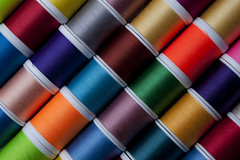 Bright colored spools of thread (Jim Corwin's PhotoStream) Tags: color detail industry thread spools horizontal creativity colorful pattern order needlework embroidery interior sewing patterns crafts craft objects nobody sew row yarn textile fabric rows photograph material brightcolors choice variety fiber multicolored sidebyside organization spindle abundance variation crafting apparel fabrics threads conformity reel spool reels manufacture yarns groupofobjects largegroupofobjects