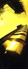 (Simon Tomlinsn) Tags: city uk england panorama london lomo xpro lomography crossprocessed britain horizon panoramic slidefilm swinglens zenit epp ektachrome lloyds lloydsbuilding lloydsoflondon kompakt kodakektachrome100 kodakepp redscale gomz horizonkompakt redscaled