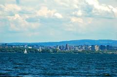 City of Syracuse Skyline (Scottwdw) Tags: city blue summer lake newyork water skyline clouds sailboat buildings landscape nikon waves d70 syracuse onondagalake afsvrzoomnikkor70200mmf28gifed yourphototips scottwdw scottthomasphotography hyrdofest