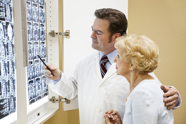 Photo of a doctor and his patient looking at x-rays