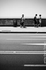 It burns (DArt 84) Tags: road street sea summer bw muro boys wall youth walking warm strada mare estate walk horizon bn napoli naples asphalt asfalto calore giovani hor orizzonte ragazzi caldo camminare cammino pentaxk10d smcpentaxda50135 mertto