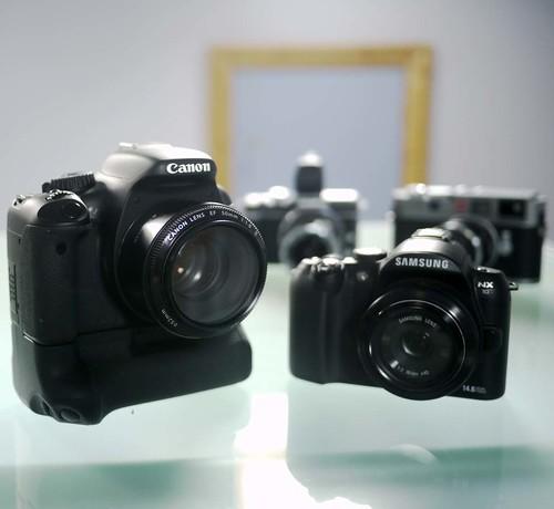 Canon 550D Samsung NX10