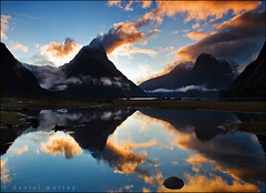 milford sunset #2 (Daniel Murray (southnz)) Tags: park sunset sea newzealand cloud mist mountain snow reflection water rock stone landscape coast scenery national nz sound southisland milford fiord fiordland southnz