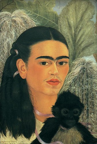 one of Frida's self portraits. Her hair is long an there is a black monkey in the foreground. Vegetation in the background.